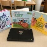 Chromebook computer and 3 books