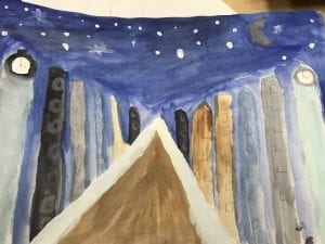 A student painting of a road in the center of the paper with buildings along each side of the road. The sky is painted to look like night with dark colors and white stars.