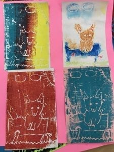 four different colored prints of a fox sitting on a log with a sunny sky