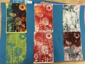 six prints of spring flowers with a sun in the sky
