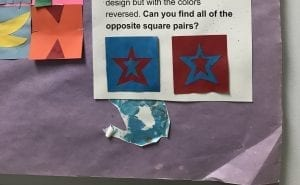An example of two squares; one is red with a blue star and the other is blue with a red star