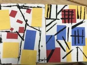 two student finished collages; they each have primary color rectangles in various spots with black straight paint lines