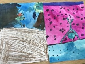 two bubble people paintings; one has someone running and the other has a handstand
