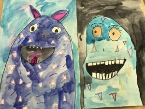 two student examples of artwork that show monsters; one looks evil and one looks happy