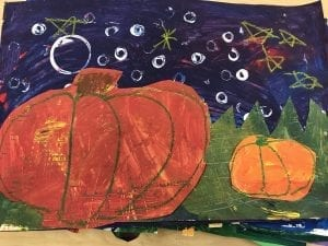 student artwork that has a purple sky with white dots, green grass, and two orange pumpkins on top of the grass