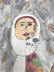 drawing of a girl with half of her face replaced by objects (a pumpkin, leaves, a cat)
