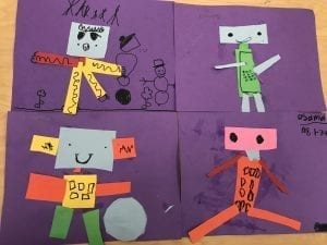 four papers that each have a robot made out of different shapes of paper glued to them, there are black marker details to show the faces, buttons, and other designs on the robots