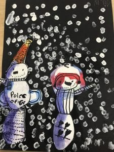 """student artwork of two snowmen; one has the words """"police officer"""" written on him and is wearing an orange hat and the other has hearts on him and has his hands above his head as if he were dancing"""