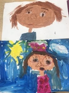 image of two paintings that show children's faces, one has a blue background with a yellow sun