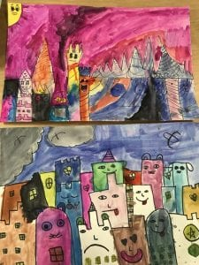 After drawing their buildings, they painted them with watercolor paints. Here are two student paintings; they have several buildings with different faces and details in various colors