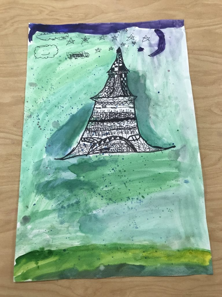 This student drew the eiffle tower with black sharpir, put designs inside of it with more black Sharpie and painted the background shades of green