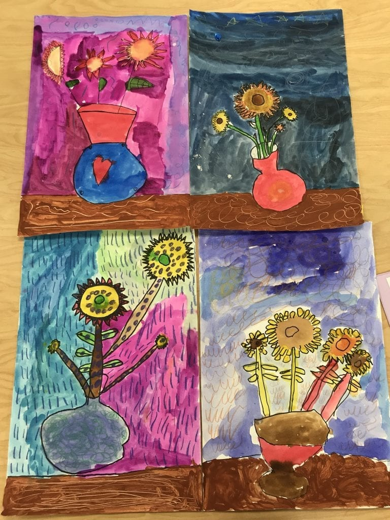 Every student painted their flowers and background different colors.