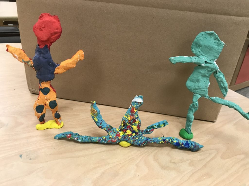 Here ae three student sculptures in different poses.