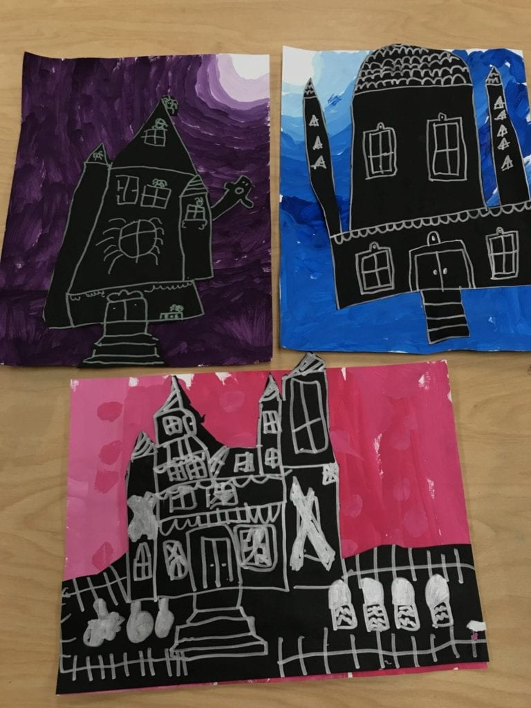 Here are three student artworks; they each have a different colored background that have five tints of a color. They drew with silver marker on black paper to show a house that has towers, trim, and windows.