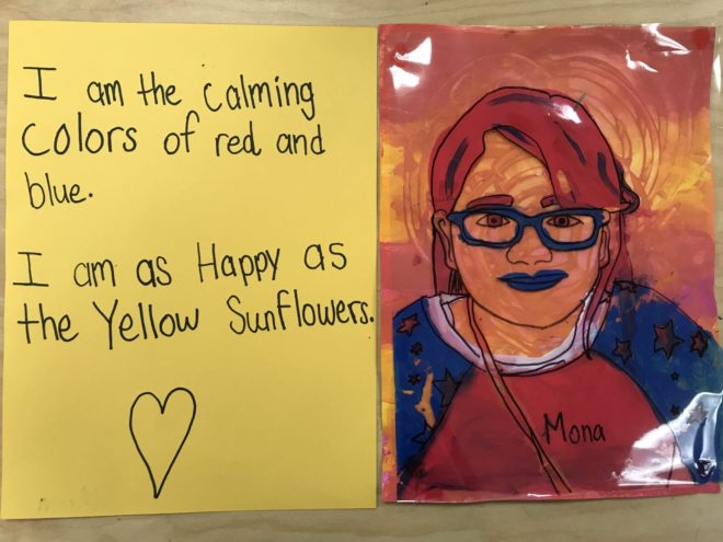 """This student painted her hair and clothes red and blue and her skin and background are painted yellow and orange. She wrote, """"I am the calming colors or red and blue. I am as happy as the yellow sunflowers."""""""
