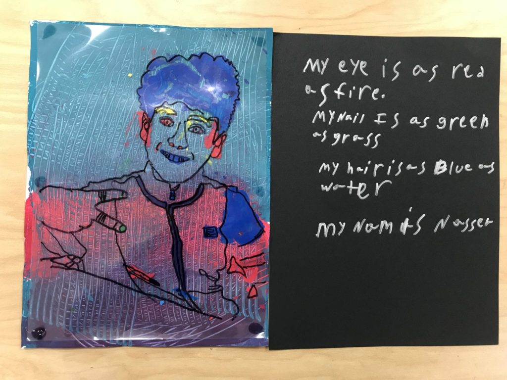 """This student painted himself red, blue, with small details in yellow and green and wrote """"My eye is as red as fire. My nail is as green as grass. My hair is as blue as water. My name is Nasser."""""""