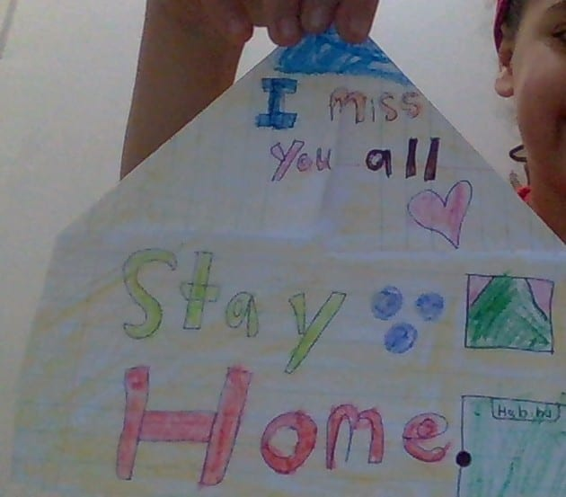 """origami folded house with """"Stay home"""" and """"I miss you all"""" written on it"""