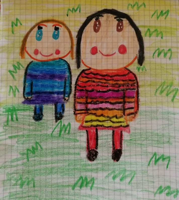 drawing of two girls one with a blue outfit and one with a pink, red, orange, yellow outfit