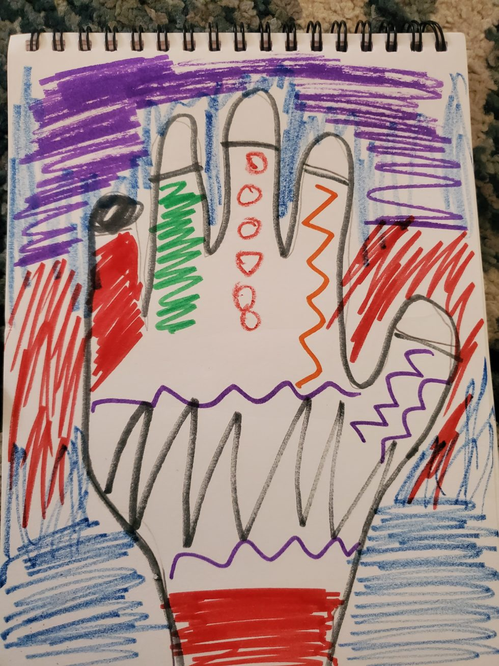 traced hand with marker lines, shapes, and marker background
