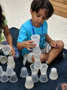 Students stacking cups