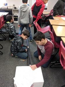 Students testing roller coasters