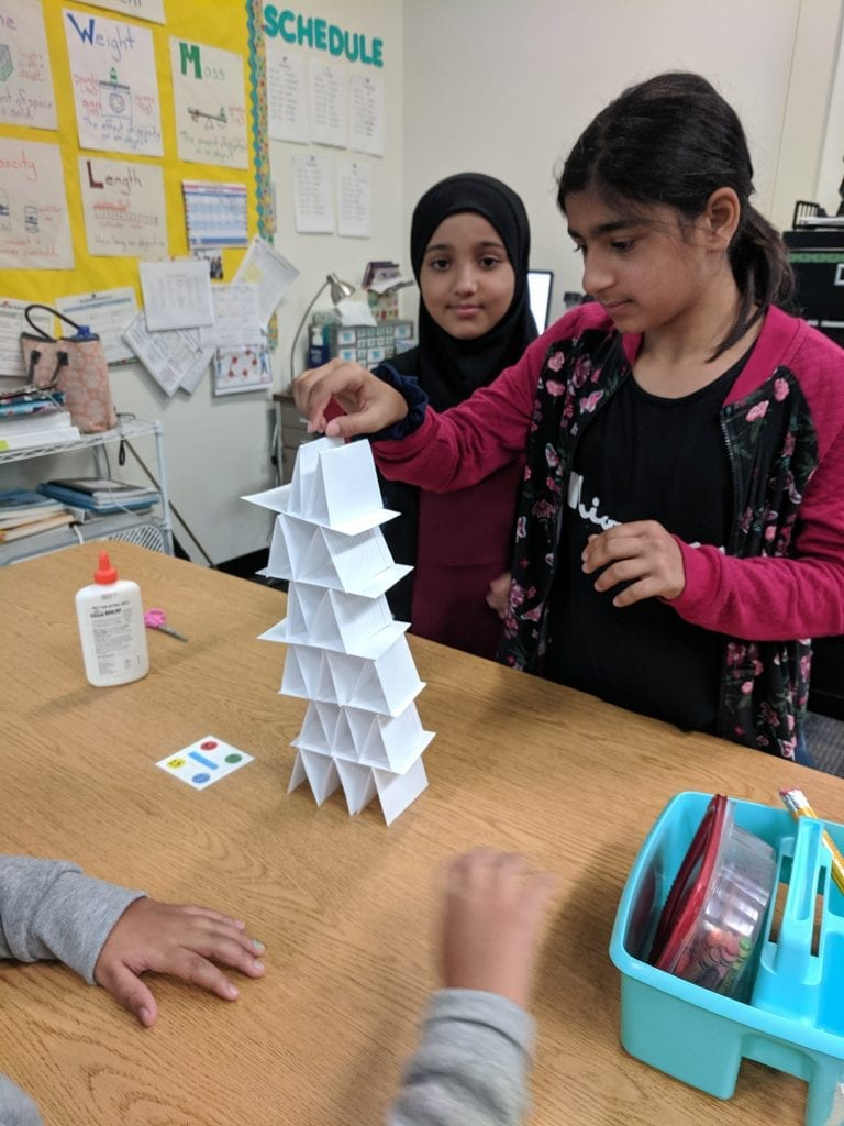Students creating a tower with index cards.