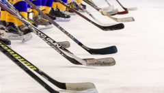 hockey sticks on ice in a row