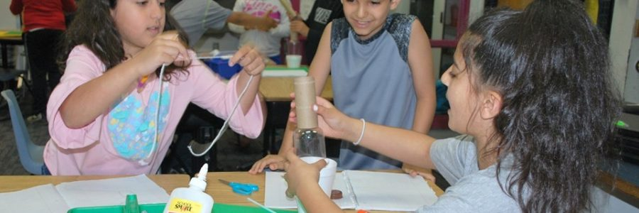 students using different materials to create a project