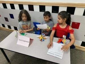 first graders explain their lego projects