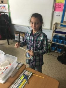 a girl shows her project