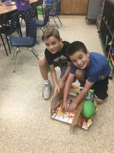2 students work on their STEAM project