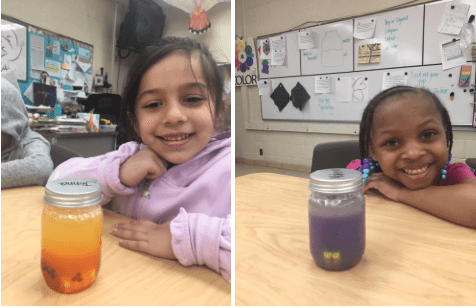 two girls showing their mindfulness jars in the art room