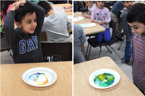 students show their fat molecules and soap experiments on paper plates in the art room