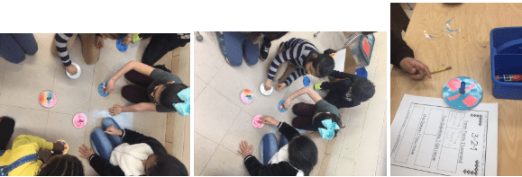 students showing their top creations on the floor of the art room