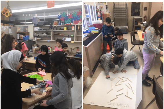 students work on their cardboard arcade games in the art room