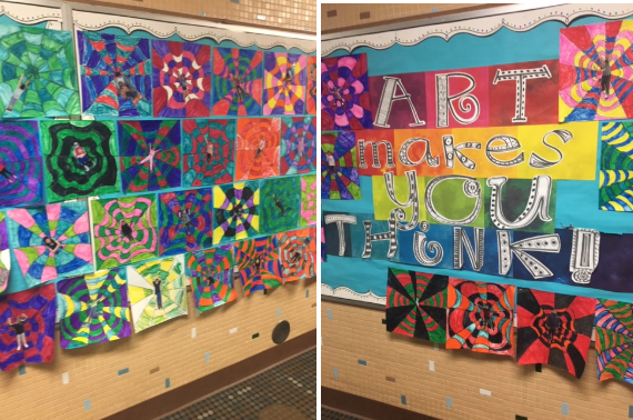 examples of student artwork hanging on the wall outside the art room
