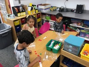3 students playing a math game