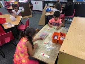 2 students playing a math game