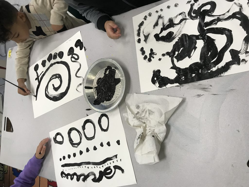 Each artist painted different typesof lines with black paint on white paper.