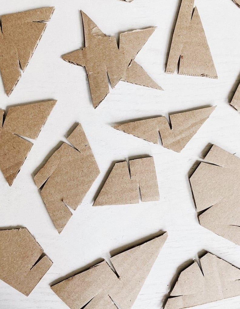 Here are different shapes of cardboard that all have 2 or more slits cut from their sides.