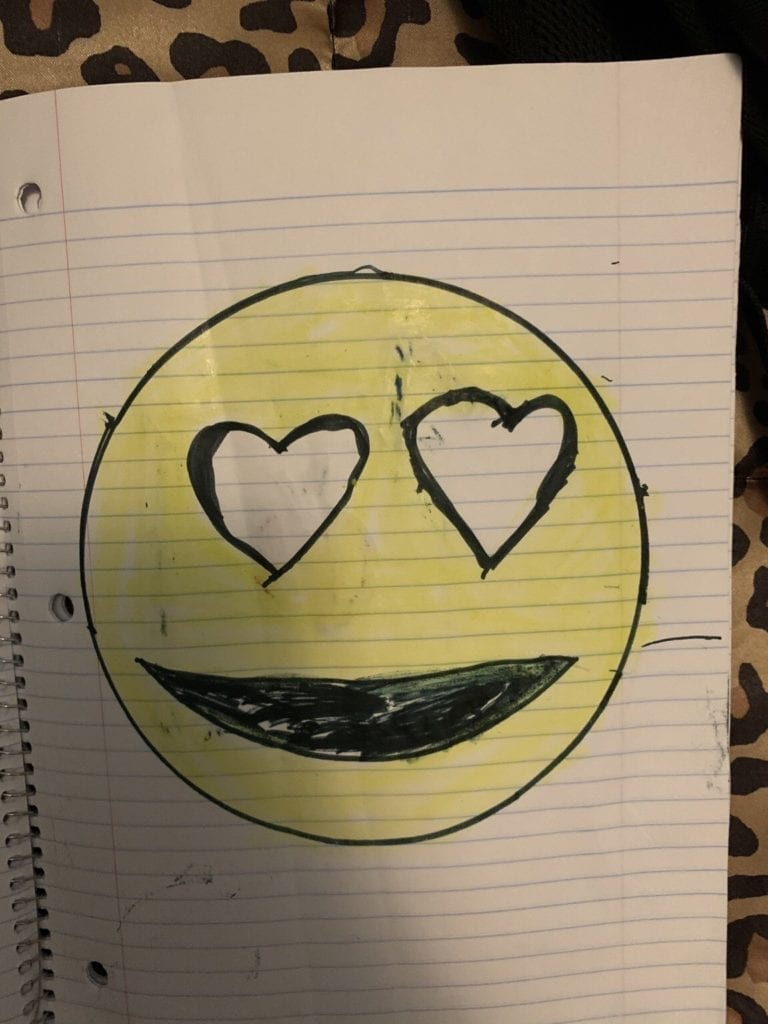 drawing of an emoji with heart eyes