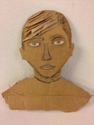 a face made from cardboard