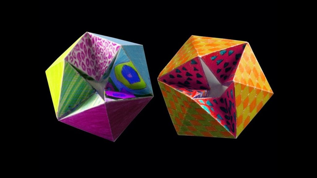 two flexagons- they are folded papers that have been colored