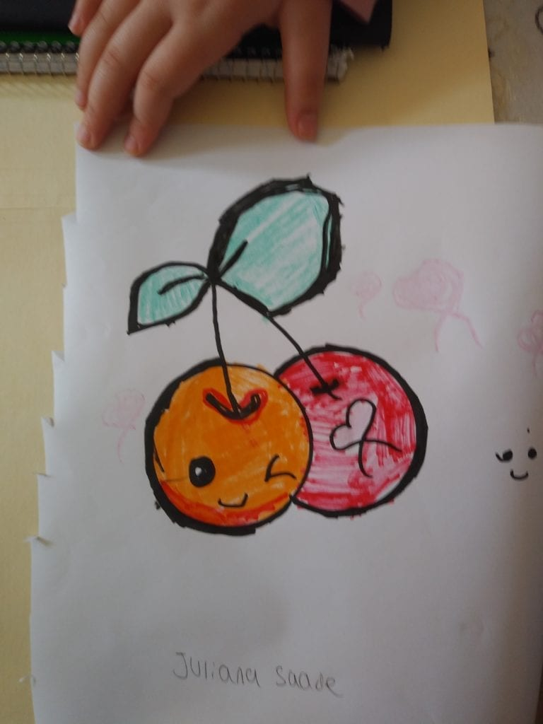two cherries connected by the stem; one cherry is orange with a winking face and the other cherry is red with a heart on it