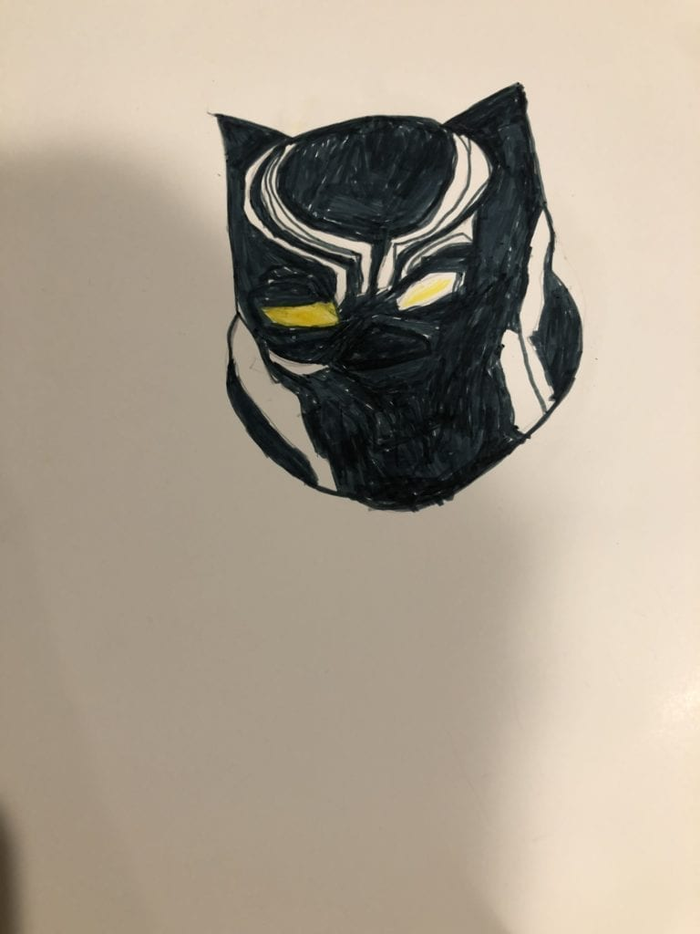 drawing of a black mask with yellow eyes