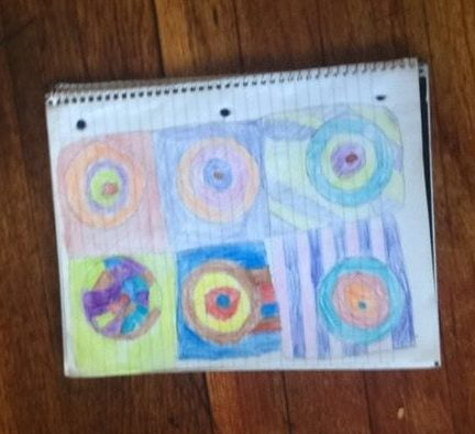 six boxes with concentric circles in them of all different colors