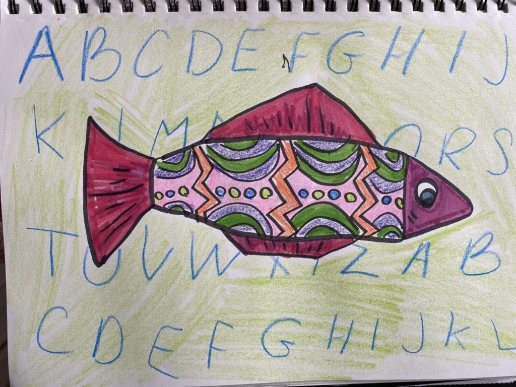colorful fish with pink fins and curved lines, dots, and orange zig zag lines in the body as a pattern, the background has the alphabet written across it and colored over in light green