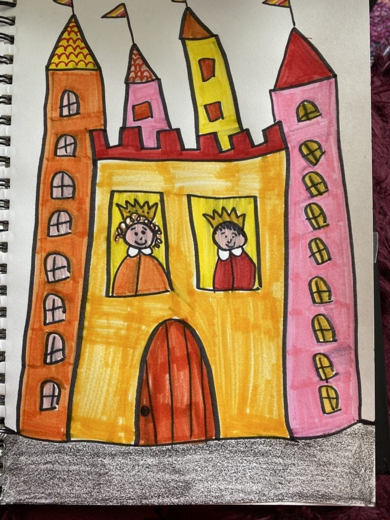Castle drawn with black marker and colored in with reds, pinks, yellows, and oranges. A king and queen are in the two front windows, there are many windows, and flags on the top of the castle.