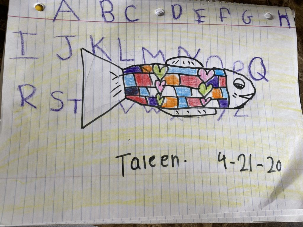 fish drawing with colorful rectangles and hearts in the body and the alphabet in the background