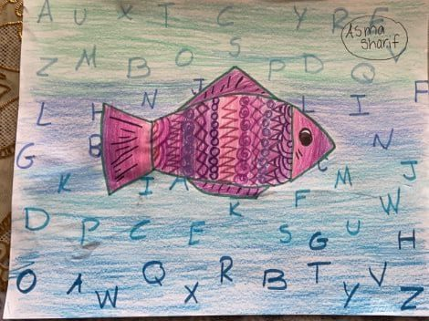pink and purple drawing of a fish with patterns in the body with a blue background and the alphabet is in the background